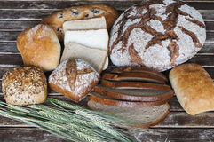 Various types of bread on a wooden table Stock Image