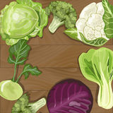 Various types of cabbage on wooden background. Stock Images