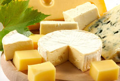 Various types of cheese. On wooden plate Stock Image