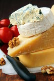 Various types of cheese. On a wooden cutting board stock photo