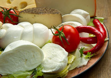 Various types of cheese. On wooden board royalty free stock photos