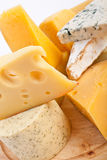 Various types of cheese. In a composition stock image