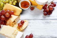 Various types cheese on a background of boards Stock Image