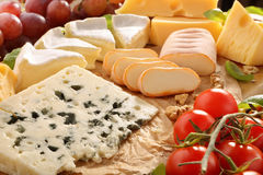 Various types of cheese board composition with tomato.  royalty free stock images