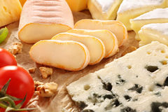 Various types of cheese board composition with tomato Stock Photography