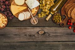 Various types of cheese and bottle of wine Royalty Free Stock Photography
