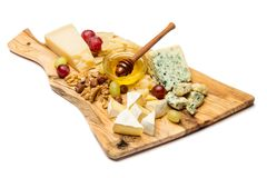 Various types of cheese - brie, camembert, roquefort and cheddar stock photos