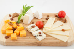 Various types of cheese composition on wooden board Stock Images