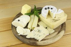 Various types of cheese on a cutting board Stock Photo