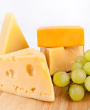 Various types of cheese with grapes. Various types of cheese with whie grapes stock photography