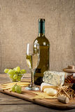 Various types of cheese, grapes, honey,  bottle of wine Royalty Free Stock Images