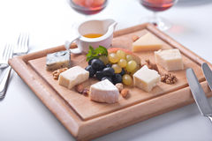 Various Types of Cheese, Honey and Grapes Royalty Free Stock Image