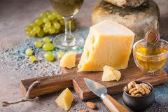Various types of cheese. With honey, grapes and wine on rustic background royalty free stock photography