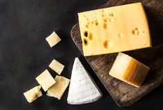 Various types cheese. Isolated black stock image