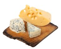Various types of cheese on old kitchen board Stock Photography
