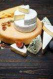 Various types of cheese - parmesan, brie, roquefort, cheddar stock images