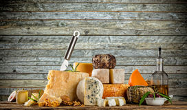 Various types of cheese placed on wooden table. Copyspace for text. Wooden planks on background stock images