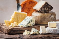 Various types of cheese. On rustic wooden table stock images