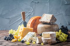 Various types of cheese. On rustic wooden table stock photos
