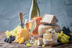 Various types of cheese. On rustic wooden table stock image
