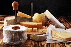 Various types of cheese on rustic wooden table. cheese platter.  stock images