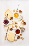 Various types of cheese with sauce, walnut and figs Stock Images