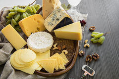 Various types of cheese set. With grapes and nuts royalty free stock photos
