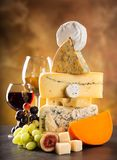 Various types of cheese. On stone table, still-life stock photos