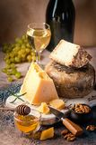 Various types of cheese. With honey, grapes and wine on rustic background stock photos