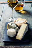 Various types of cheese and white wine Stock Image