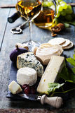 Various types of cheese and white wine Stock Photos