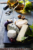 Various types of cheese and white wine Royalty Free Stock Photography