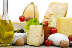 Various types of cheese on white wood Royalty Free Stock Photography