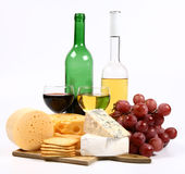 Various types of cheese, wine, grapes and crackers Stock Photo