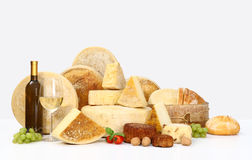 Various types of cheese with wine, grapes, tomatoes, basil, Stock Image