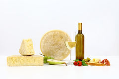Various types of cheese with wine, tomatoes, basil, olives, ham, Stock Photo