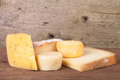 Various types of cheese on a wooden background Royalty Free Stock Image