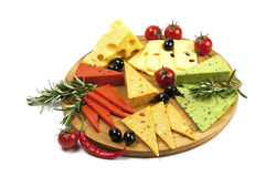 Various types of cheese on a wooden  board Royalty Free Stock Photo