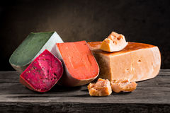 Various types of cheese. On a wooden board Royalty Free Stock Photography