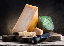 Various types of cheese. On a wooden board Stock Photography