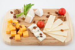 Various types of cheese on wooden board Royalty Free Stock Photography