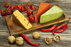 Various types of cheese on a wooden  board Royalty Free Stock Image