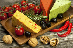 Various types of cheese on a wooden  board Royalty Free Stock Images