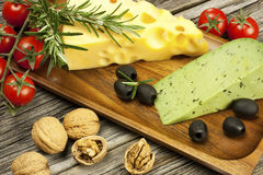 Various types of cheese on a wooden  board Stock Images