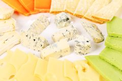 Various types of cheese on wooden platter. Stock Image