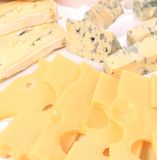 Various types of cheese on wooden platter. Stock Photography