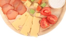 Various types of cheese on wooden platter. Stock Photos