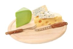 Various types of cheeses on wood. Royalty Free Stock Photography