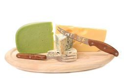 Various types of cheeses on wood Stock Image