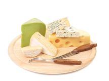 Various types of cheeses on wood. Stock Photos